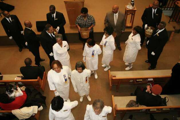 Ushers of Fairfield County march down the aisle during the 32nd Annual Dr. Martin Luther King, Jr. celebration at Mount Avery Baptist Church in Bridgeport on Monday, Feb. 17, 2011. Photo: B.K. Angeletti / Connecticut Post