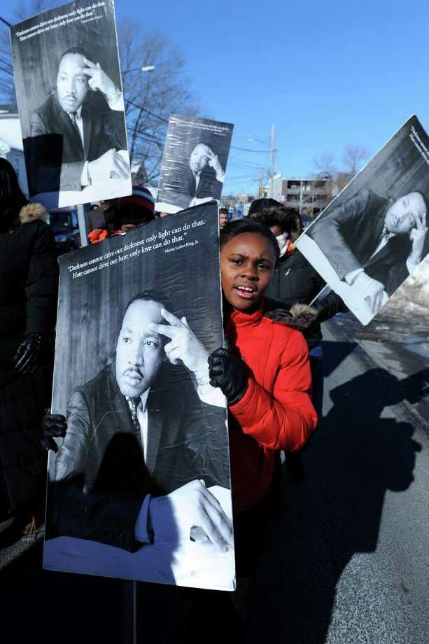 Masani Pettway, 9, walks in the annual Martin Luther King Jr. commemorative march on Hollister Ave. in Bridgeport, Conn. Jan. 17th, 2011. Photo: Ned Gerard / Connecticut Post