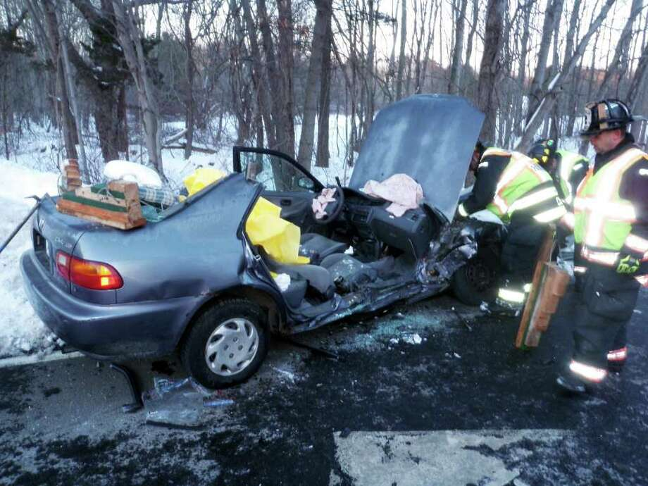 Two people had to be cut by firefighters from this Honda that crashed Sunday afternoon at Greens Farms Road and the Sherwood Island Connector. Photo: Contributed Photo/Westport Fire Department, Contributed Photo