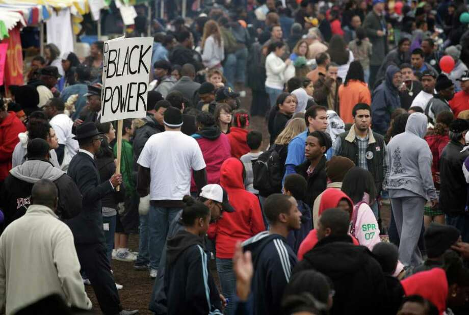 Brother Brian X, left, carries a Black Power sign as the 24th City of San Antonio Martin Luther King. Jr. Commemorative March reaches Pittman Sullivan Park, Monday, Jan. 17, 2011. photo Bob Owen/rowen@express-news.net Photo: BOB OWEN, SAN ANTONIO EXPRESS-NEWS / SAN ANTONIO EXPRESS-NEWS