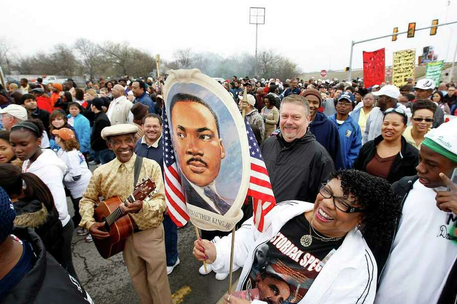 Robbie Thompson, center front, enjoys the  24th anniversary of San Antonio's official Martin Luther King Jr Commemorative March, Monday, Jan. 17, 2011. Thompson and tens of thousands others particiapted in this year's march. JERRY LARA/glara@express-news.net Photo: JERRY LARA, SAN ANTONIO EXPRESS-NEWS / glara@express-news.net