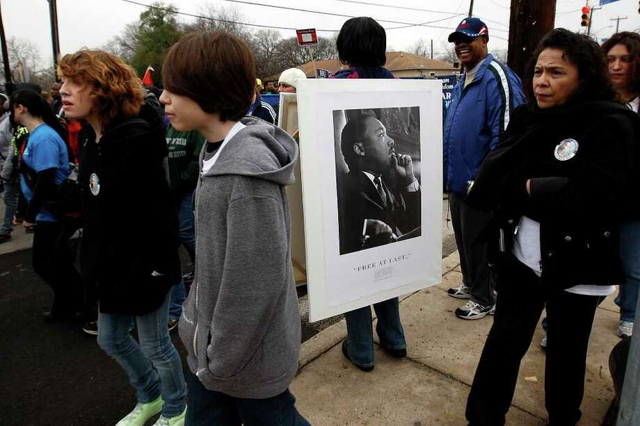 Pat Thorn wears a portraits of Martin Luther King during the 24th anniversary of San Antonio's official Martin Luther King Jr Commemorative March, Monday, Jan. 17, 2011. Tens of thousands people participated in this year's march that started at 3501 Martin Luther King Drive and ended three miles away at Pittman-Sullivan Park. JERRY LARA/glara@express-news.net Photo: JERRY LARA, SAN ANTONIO EXPRESS-NEWS / glara@express-news.net