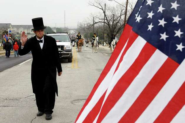 """Abe Lincoln,"" aka John Tolleson, participates in the 24th anniversary of San Antonio's official Martin Luther King Jr Commemorative March, Monday, Jan. 17, 2011. JERRY LARA/glara@express-news.net Photo: JERRY LARA, SAN ANTONIO EXPRESS-NEWS / glara@express-news.net"