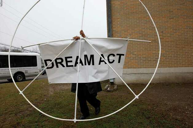 Javier Hernandez, proponent of the Dream Act, prepares to participate in the 24th anniversary of San Antonio's official Martin Luther King Jr Commemorative March, Monday, Jan. 17, 2011. It was also the 25th anniversary of the declaration of a national holiday. JERRY LARA/glara@express-news.net Photo: JERRY LARA, SAN ANTONIO EXPRESS-NEWS / glara@express-news.net