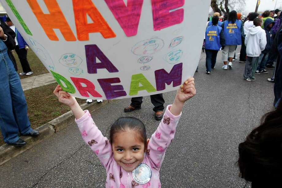Four-year-old Juliann Olguin, (cq), holds up her sign at the start of the 24th anniversary of San Antonio's official Martin Luther King Jr Commemorative, Monday, Jan. 17, 2011. JERRY LARA/glara@express-news.net Photo: JERRY LARA, SAN ANTONIO EXPRESS-NEWS / glara@express-news.net