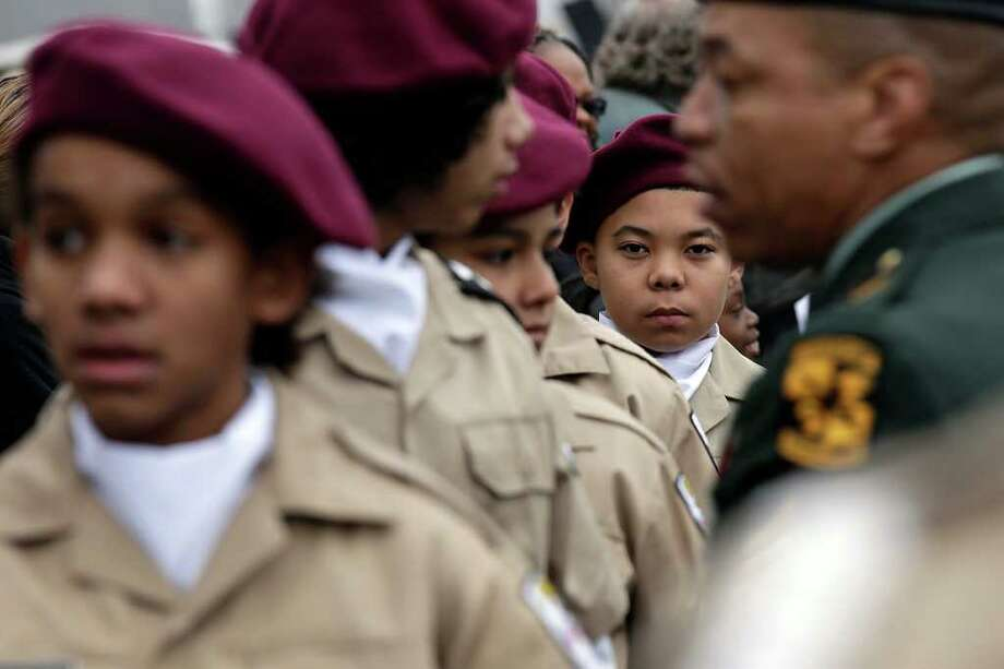 Javon County, 13, stands at attention with other members of the Wheatley Middle School Leadership Officers Training Corps at the start of the 24th anniversary of San Antonio's official Martin Luther King Jr Commemorative March, Monday, Jan. 17, 2011. JERRY LARA/glara@express-news.net Photo: JERRY LARA, SAN ANTONIO EXPRESS-NEWS / glara@express-news.net