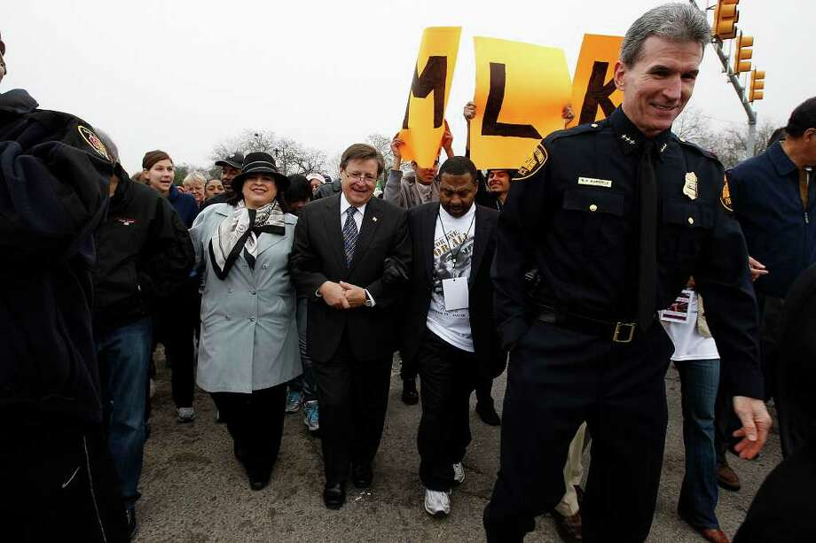 "State Sen. Leticia Van de Putte, from left and U.S. Congressman Francisco ""Quico"" Canseco, MLK Commission Chair Pastor Otis Mitchell and San Antonio Police Chief William McManus participate in the 24th anniversary of San Antonio's official Martin Luther King Jr Commemorative March, Monday, Jan. 17, 2011. It was also the 25th anniversary of the declaration of a national holiday. JERRY LARA/glara@express-news.net Photo: JERRY LARA, SAN ANTONIO EXPRESS-NEWS / glara@express-news.net"