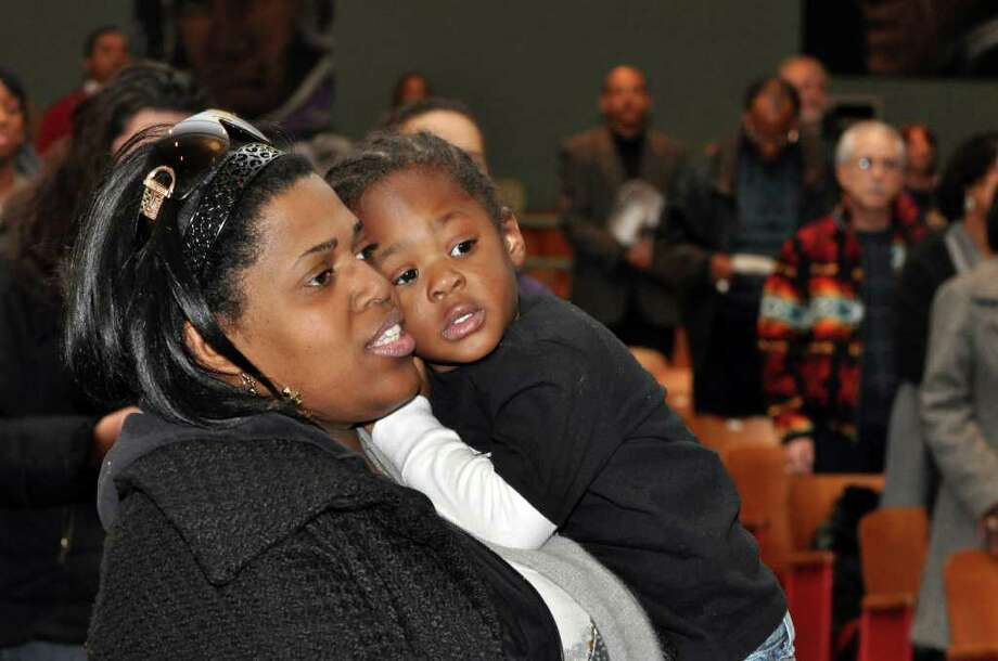 Patricia Chery, of Norwalk, holds her nephew Jacob Chery, 2.5, as she sings Lift Every Voice and Sing during the Dr. Martin Luther King, Jr. Celebration at West Rocks Middle School in Norwalk on Monday, Jan. 17, 2011. Photo: Amy Mortensen / Connecticut Post Freelance