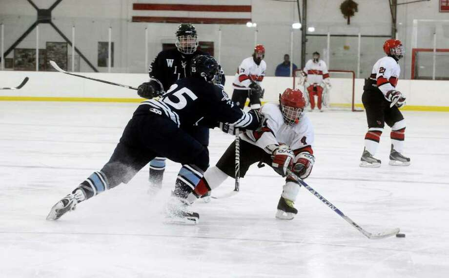 Greenwich High School's # 4, William Waesche, in the ice hockey game against Wilton High School, hosted by Greenwich, at the Dorothy Hamill Skating Rink in Byram, on Monday, Jan. 17, 2011. Photo: Helen Neafsey / Greenwich Time