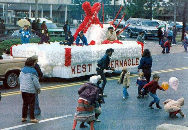"""""""Children scurry about, snatching sweets tossed from a float during Saturday's downtown Mardi Gras parade in Beaumont."""" Enterprise file photo Feb. 1987"""