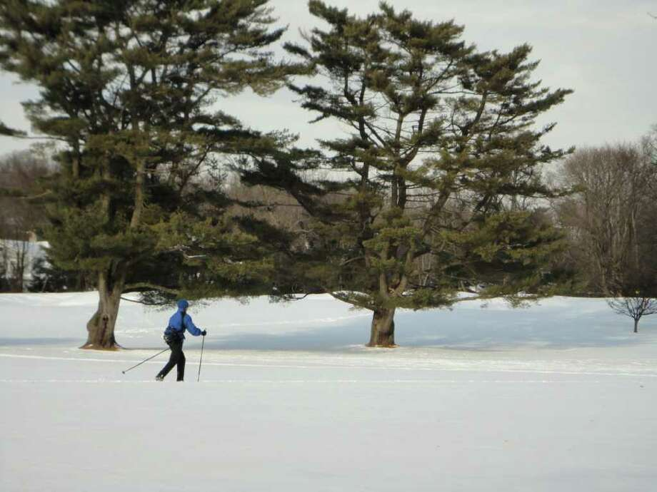 Kathy Rockwood, of Westport, enjoys the quiet setting of the snow-covered golf course as she skiied cross-country style Saturday at Longshore Park. Rockwood lives close to the municipal park. Photo: Meg Barone / Westport News freelance