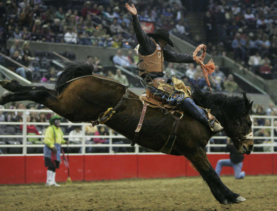Taos Muncy of Corona, New Mexico, rides Betsy Brown during the Saddle Bronc Riding at the AT&T Center. Photo: Express-News File Photo