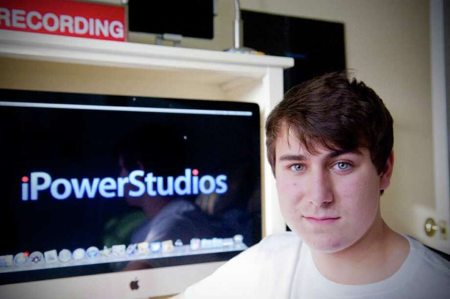 iPowerStudios founder Alex Britton, 14, creates iPhone and iPad apps in the bedroom studio of his parents' home in Darien, Conn., Sunday, January 16, 2011.. Over time his more than 75,000 of his creations have been downloaded. Photo: Keelin Daly / Stamford Advocate