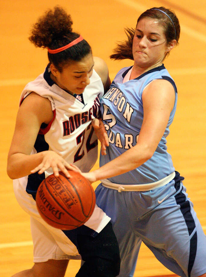 Amber Green of No. 3 Roosevelt (left) looks for room around Johnson's Brie Foresman during Roosevelt's 88-65 District 26-5A victory last week. Photo: EDWARD A. ORNELAS, SAN ANTONIO EXPRESS-NEWS