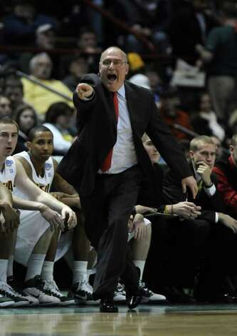 Siena head coach Mitch Buonaguro yells during the first half of Siena's 73-69 win over Canisius at the Times Union Center in Albany, NY on Monday night January 17, 2011. ( Philip Kamrass / Times Union ) Photo: Philip Kamrass