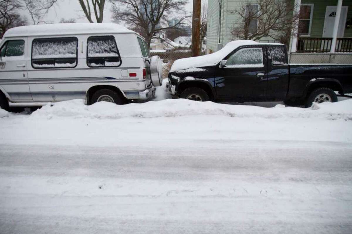 Cars are covered in snow in during a snow and ice storm in Stamford, Conn. on Tuesday, Jan. 18, 2011.