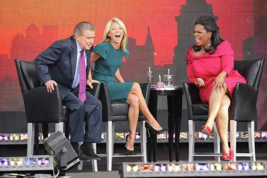 NEW YORK - SEPTEMBER 18:  TV personalities Regis Philbin, Kelly Ripa and Oprah Winfrey appear on The Oprah Winfrey Show: Fridays Live From New York at Rumsey Playfield on September 18, 2009 in New York City.  (Photo by Michael Loccisano/Getty Images) *** Local Caption *** Regis Philbin;Kelly Ripa;Oprah Winfrey Photo: Michael Loccisano, Getty Images / 2009 Getty Images