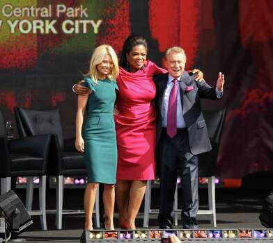 NEW YORK - SEPTEMBER 18:  TV personalities Kelly Ripa, Regis Philbin and Oprah Winfrey appear on The Oprah Winfrey Show: Fridays Live From New York at Rumsey Playfield on September 18, 2009 in New York City.  (Photo by Michael Loccisano/Getty Images) *** Local Caption *** Kelly Ripa;Regis Philbin;Oprah Winfrey Photo: Michael Loccisano, Getty Images / 2009 Getty Images
