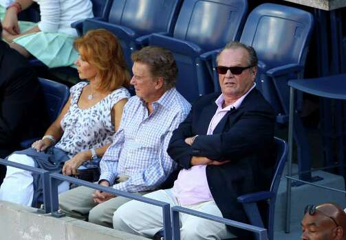 NEW YORK - SEPTEMBER 14:  (L-R) Joy Philbin, Regis Philbin and Jack Nicholson watch the match between Roger Federer of Switzerland and Juan Martin Del Potro of Argentina on day fifteen of the 2009 U.S. Open at the USTA Billie Jean King National Tennis Center on September 14, 2009 in the Flushing neighborhood of the Queens borough of New York City.  (Photo by Julian Finney/Getty Images) *** Local Caption *** Jack Nicholson;Regis Philbin;Joy Philbin Photo: Julian Finney, Getty Images / 2009 Getty Images