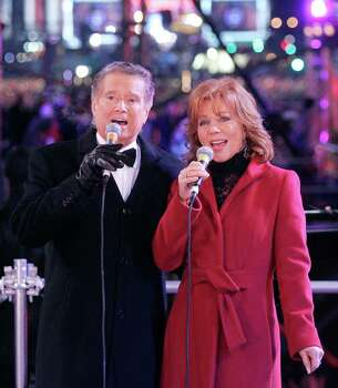 NEW YORK - JANUARY 1: Regis Philbin and wife Joy sing during the New Year's  celebration, January 1, 2006 in Times Square in New York City. (Photo by Stephen Chernin/Getty Images) Photo: Stephen Chernin, Getty Images / 2006 Getty Images