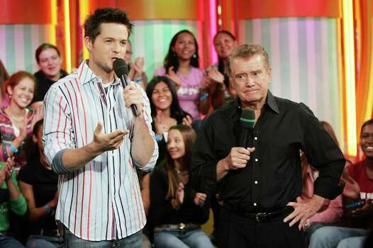 NEW YORK - OCTOBER 6: (U.S. TABS OUT)  Regis Philbin appears on stage with host Damien Fahey during MTV's Total Request Live at the MTV Times Square Studios October 6, 2004 in New York City. (Photo by Scott Gries/Getty Images) Photo: Scott Gries, Getty Images / 2004 Getty Images