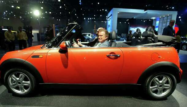 NEW YORK - APRIL 7:  Television personality Regis Philbin checks out the new Mini Cooper convertible at a press preview of the 2004 New York International Auto Show April 7, 2004 in New York City.  The show will be open to the public April 9-18.  (Photo by Mario Tama/Getty Images) Photo: Mario Tama, Getty Images / 2004 Getty Images