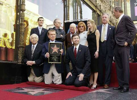 HOLLYWOOD - APRIL 10:  Talk show host Regis Philbin (M) poses for a photograph after receiving a Star on the Hollywood Walk of Fame on April 10, 2003 in Hollywood, California.  (Photo by Robert Mora/Getty Images) Photo: Robert Mora, Getty Images / 2003 Getty Images