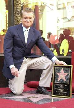 HOLLYWOOD - APRIL 10:  Talk show host Regis Philbin poses for a photograph after receiving a Star on the Hollywood Walk of Fame on April 10, 2003 in Hollywood, California.  (Photo by Robert Mora/Getty Images) Photo: Robert Mora, Getty Images / 2003 Getty Images