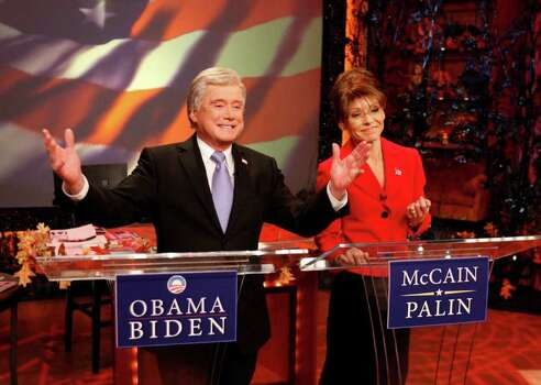 "In this image released by Disney-ABC Domestic Television, hosts Regis Philbin, left, dressed as Democratic vice-presidential candidate Sen. Joe Biden, and Kelly Ripa, dressed as Republican vice-presidential candidate Sarah Palin are shown during their annual Halloween extravaganza on ""Live with Regis and Kelly,"" on Friday, Oct. 31, 2008, in New York. (AP Photo/Disney-ABC Domestic Television) ** NO SALES ** Photo: Anonymous, HO / AP2008"