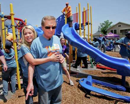 "Morning talk show hosts Regis Philbin right, and Kelly Ripa, pause as they help assemble a playground at an elementary school in New Orleans Monday, May 21, 2007. The ""Live with Regis and Kelly"" show will be taping in New Orleans through Wednesday. They were at Charles Drew Elementary School that was damaged during Hurricane Katrina.(AP Photo/Alex Brandon) Photo: Alex Brandon, STF / AP2007"