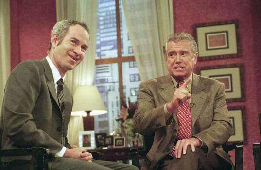 Regis Philbin, right, host of ABC?s ?Live with Regis and Kathy Lee,? gestures during a visit to the show by John McEnroe on Oct. 7, 1999 in New York. After years as a journeyman on television?s daytime and late-night fringes, Philbin is suddenly a prime-time star after he success of ?Who Wants to be a Millionaire,? the ABC quiz show he hosted late this summer. (AP Photo/Jeff Geissler) Photo: Jeff Geissler, STR