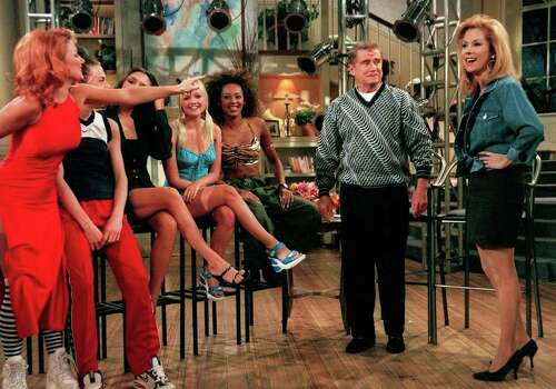 "Kathie Lee Gifford, right, smiles as ""Ginger Spice"" Geri, far left, points to the kiss she planted on Regis Philbin, second from right, during the ""Spice Girls"" appearance on the television show ""Live with Regis and Kathie Lee,"" Friday, May 16, 1997, in New York.  The other members of the group, from left, are: ""Sporty Spice"" Melanie C., ""Posh Spice"" Victoria, ""Baby Spice"" Emma and ""Scary Spice"" Melanie B.""   (AP Photo/Steve Friedman,Buena Vista Television) Photo: STEVE FRIEDMAN / AP1997"
