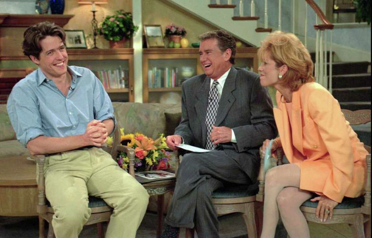 """Actor Hugh Grant jokes with Regis Philbin, center, and Kathie Lee Gifford on the set of """"Live With Regis and Kathie Lee,"""" in New York Friday, July 14, 1995."""