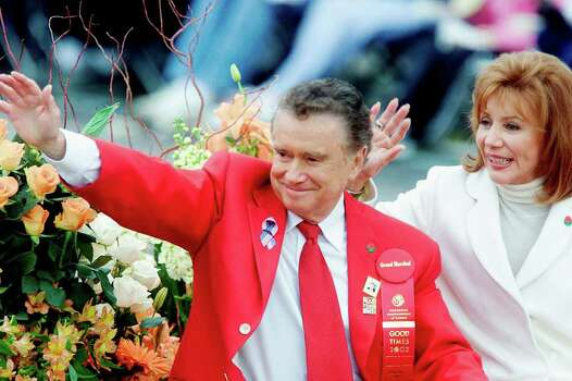 "Grand Marshal Regis Philbin, host of television's ""Who Wants to Be a Millionaire,"" and his wife Joy wave to the crowd as they make their way down Colorado Boulevard in the 113th annual Rose Parade Tuesday, Jan. 1, 2002, in Pasadena, Calif.  (AP Photo/Damian Dovarganes) Photo: DAMIAN DOVARGANES, STF / AP2002"
