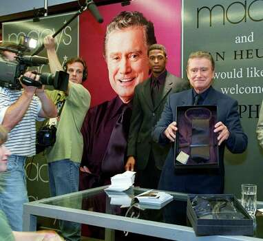 "Television personality Regis Philbin, right, shows an eggplant colored shirt and tie to the media Monday, June 12, 2000, at Macy's in New York. Philbin is launching his new men's clothing line, ""Regis by Van Heusen,"" which promises to capture the style of the ""Who Wants to be a Millionaire"" host. (AP Photo/Stuart Ramson) Photo: STUART RAMSON, STR / AP2000"