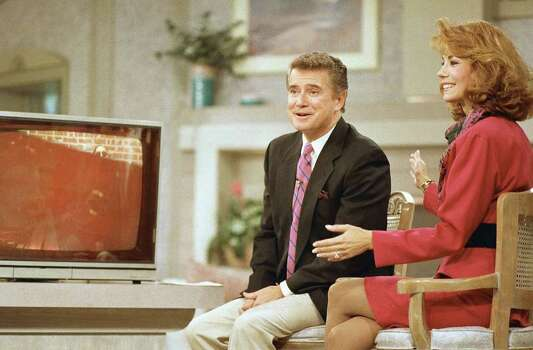 Regis Philbin and Kathie Lee Gifford react to Walter Hudson, on monitor, walking out of his Long Island home for the first time in 18 years during a broadcast of the ?Live with Regis and Kathie Lee? WABC-TV program on Thursday, Sept. 8, 1988 in New York. Hudson said he was down from his 1,200-1,400 pound weight last year to about 520 pounds. (AP Photo/Gerald Herbert) Photo: Gerald Herbert, STR