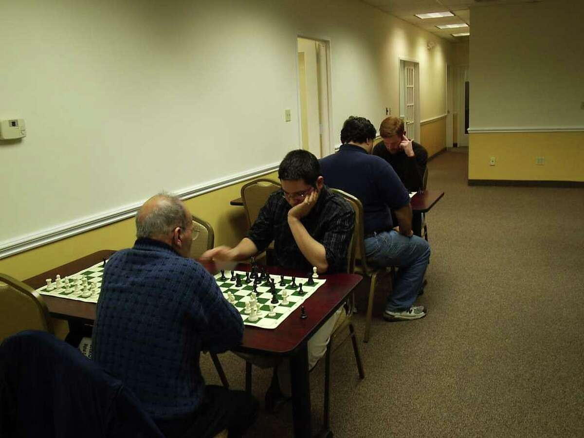 Daniel Lowinger plays chess with a member at the club.