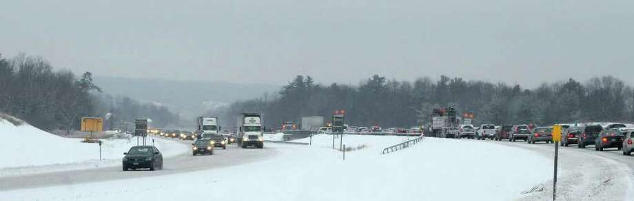 Traffic moves slowly Tuesday along I-90 near Rensselaer.   (Paul Buckowski / Times Union) Photo: Paul Buckowski / 10011776A