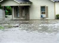 Several homes near Pine Street are flooded in Beaumont, Saturday. Tammy McKinley/