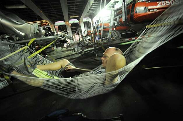 After working 18 hours Thursday, United States Coast Guard's Chris Farrell relaxes in a hammock on the Cape Vincent to rest up for what Hurricane Ike will bring Southeast Texas Friday night. Guiseppe Barranco/ Photo: THE ENTERPRISE