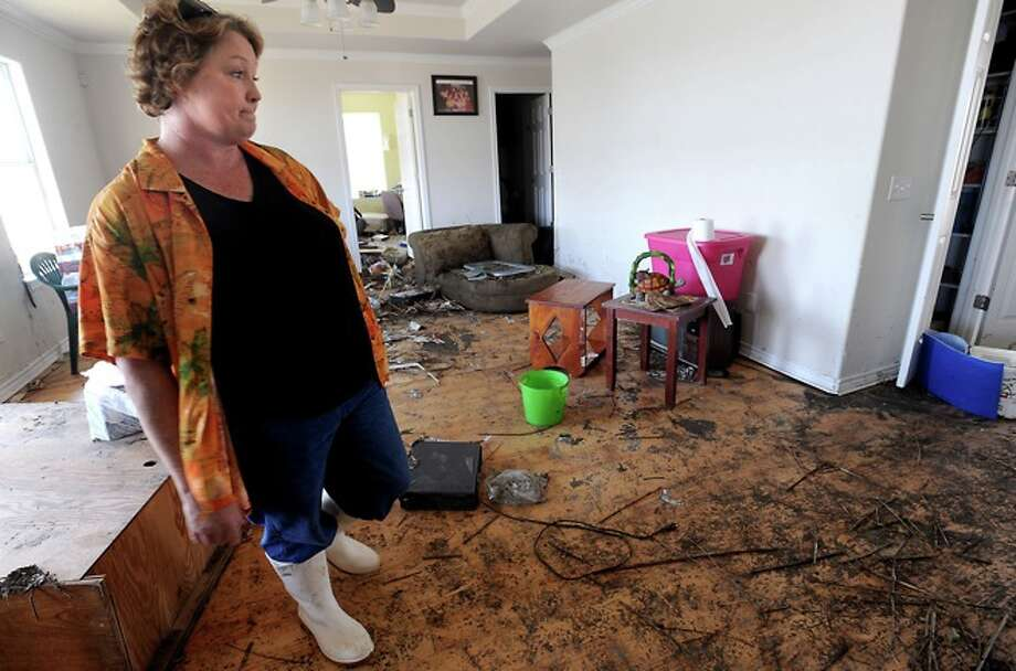 Lorrie Seymour talks about the damage to her home in Sabine Pass, Tusday. Tammy McKinley/ Photo: THE ENTERPRISE