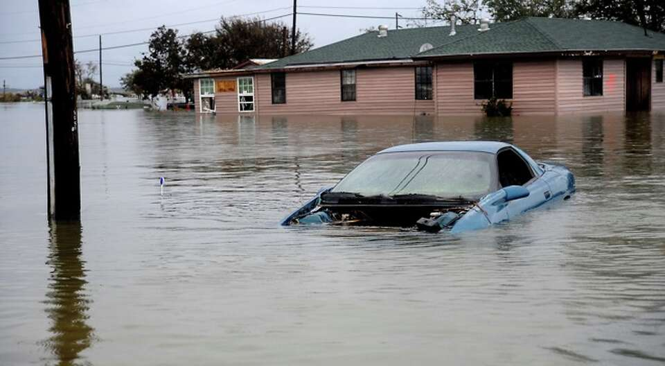 A car is submerged in flood waters in Sabine Pass, Sunday. Tammy McKinley/