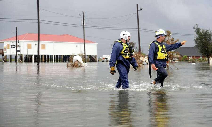 Rescue  workers  search for residents  in   Sabine Pass, Sunday. Tammy McKinley/