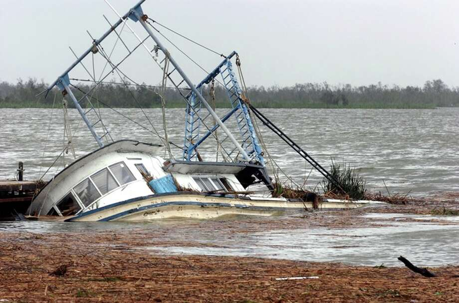 Several shrimp boats near Texas 73  in Port Arthur were sunk by the severe water surge from Hurricane Ike. Photo: Guiseppe Barranco/The Enterprise. Click through to see more photos from Ike. Photo: THE ENTERPRISE