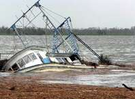 Several shrimp boats near Texas 73  in Port Arthur were sunk by the severe water surge from Hurricane Ike's. Guiseppe Barranco/