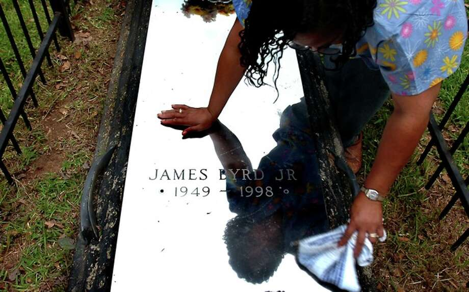 Betty Boatner cleans the grave of her brother, James Byrd, Jr at the Jasper City Cemetary in Jasper, TX Thursday, May 22, 2008.  Beaumont Enterprise, Tammy McKinley