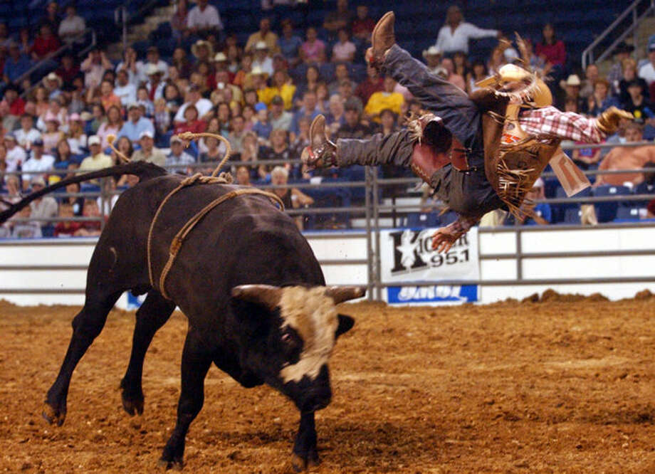 Steve Oddy, from Denton,, sails off of Smokeless Johnny Rotten in the first round at the PRCA Xtreme Bull Rides in October, 2004. Jennifer Reynolds/ Photo: THE ENTERPRISE