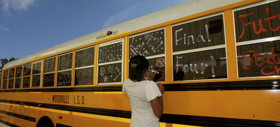 Woodville Cheerleader Ashley Mitchell uses another color for another  bus window. Photo: Dave Ryan