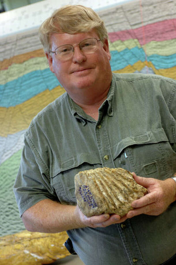 Jim Westgate with mammoth tooth found in Caplen, Texas at the home of Lamar University faculty colleague Dorothy Sisk.