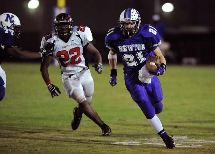 Newton's James Burch runs the ball against Kirbyville during a match up at the Eagle's stadium Frida